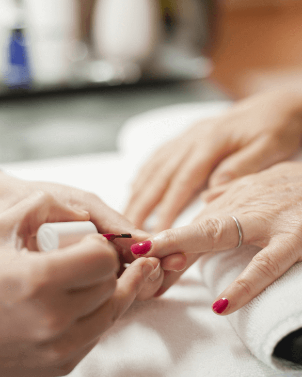 Woman getting her nails done
