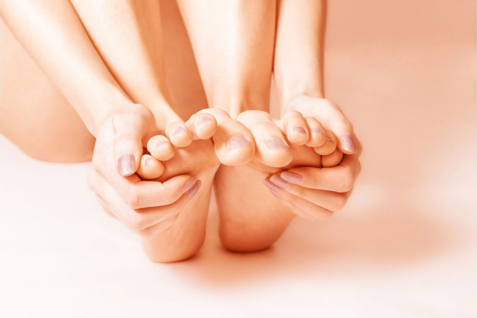 hands touching feet