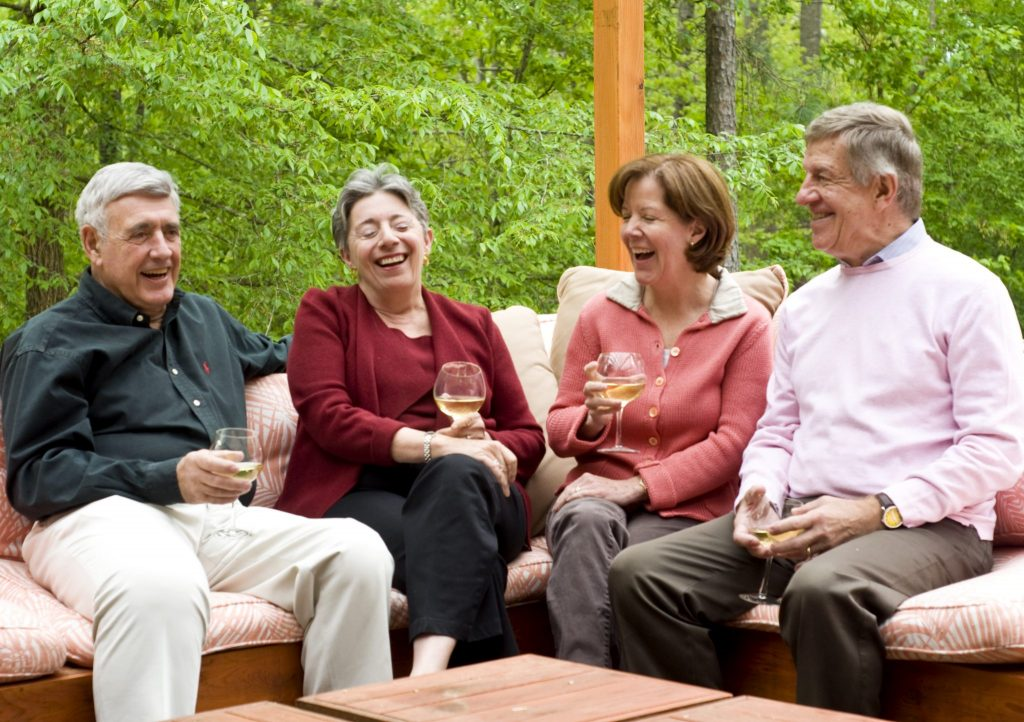 adults enjoying a glass of wine