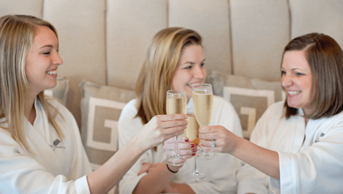 Bridal party with champagne at the Spa at Fearrington